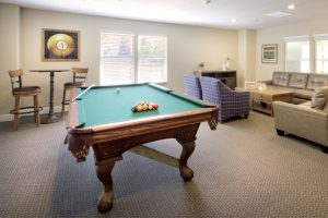 Pool table room with lounge area and table sitting area